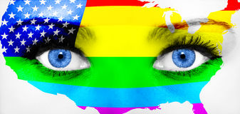 Close up of eyes. Painted face with rainbow flag Royalty Free Stock Photo