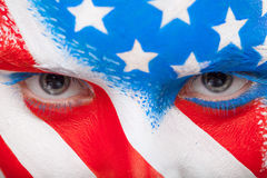 Close up of eyes. Painted face with USA flag looking at camera Stock Photo