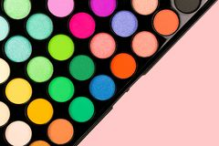 Close-up of eyeshadow palette with many shades. Makeup and beauty concept. Flat lay, top view royalty free stock photo