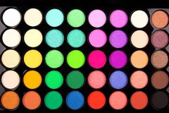 Close-up of eyeshadow palette with many shades. Makeup and beauty concept. Flat lay, top view royalty free stock photography