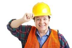 Close up fêmea do trabalhador da construção fotografia de stock