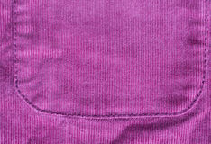 Close up of fabric or clothing item with pocket. Clothes and textile concept - close up of velveteen fabric or clothing item background Royalty Free Stock Images