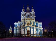Close up facade of Smolny Cathedral under illumination, Saint Petersburg, Russia. Deep winter night. Dark sky background. Travel destinations concept stock photography