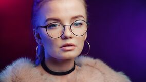 Close up face of adorable glamorous girl wearing classy glasses. Shot with RED camera in 4K
