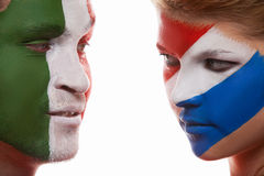 Close up of face art. Couple with painted faces look at each other Stock Photo
