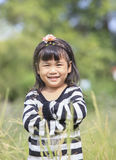 Close up face of asian children toothy smiling face happiness em Royalty Free Stock Image