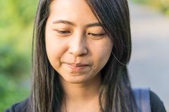Close up face of asian girl thinking on the stree. Close up face of asian girl thinking Stock Photo