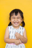 Close up face of asian kid toothy smiling facial face with happi Stock Photos