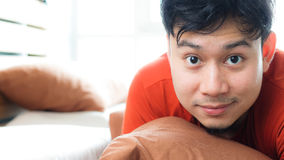 Close up face of Asian man on bed. Stock Photography