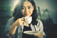 Close up face of asian woman with hot coffee cup ready to drink Royalty Free Stock Images