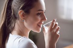 Happy healthy girl holding glass drink still water royalty free stock image