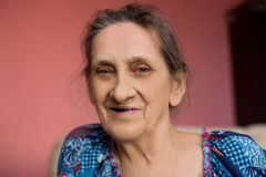 Close up face of beautiful smiling woman with wrinkles. Elderly senior. Royalty Free Stock Photography