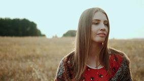 Close up face beautiful woman on field wheat on sunset, countryside smiling look at camera. Organic products concept stock footage