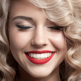 Close up face of beautiful Woman. Healthy Curly Hair. Gorgeous s. Close up face of beautiful young Woman. Healthy Curly Hair. Gorgeous smile Stock Images