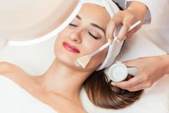 Close-up of a beautiful woman relaxing during facial treatment in beauty center Royalty Free Stock Photography