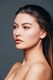 Close up of face beauty girl skin on grey background. Cosmetics or spa, healtcare concept. Royalty Free Stock Photos