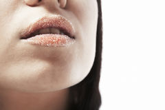 Close-up face of beauty young woman - sugar lips. Royalty Free Stock Image