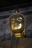Close up face of bronze buddha statue at Bangkok temple in Thailand in Asian culture and religion Royalty Free Stock Photos