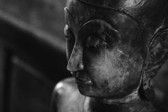 Close up face on buddha head statue and black and white image style. Royalty Free Stock Photography
