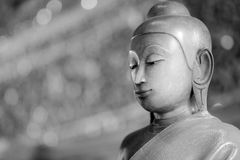 Close up face on buddha head statue with Bokeh background Stock Photo
