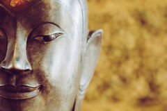 Close up face on buddha head statue with Bokeh background Royalty Free Stock Photos