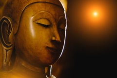 Close up face on buddha head statue with lighting effect. Stock Photo