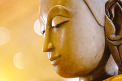 Close up face on buddha head statue with lighting effect. Royalty Free Stock Photos