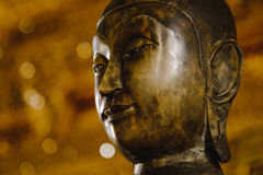 Close up face on buddha head statue with lighting effect. Royalty Free Stock Image