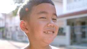 Close up face of cheerful asian children happiness emotion standing outdoor stock video