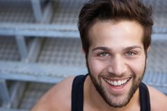 Close up face of a cheerful young man Stock Photography