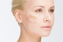 Close-up face with cosmetic foundation Royalty Free Stock Images