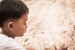 Close up of face cute little boy play sand Royalty Free Stock Images