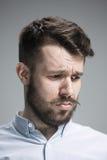 Close up face of  discouraged man. Close up of face of discouraged man on gray background Stock Images