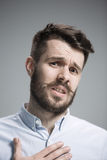 Close up face of  discouraged man. Close up of face of discouraged man on gray background Royalty Free Stock Images