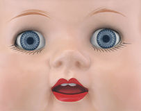 Close-up of the face of a doll. Royalty Free Stock Photography