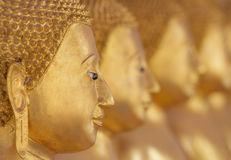Close up face of golden buddha Stock Photos