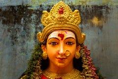 A close up on the face of an idol of Goddess Durga.  Stock Photos