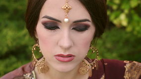 Close-up of girl in Indian traditional jewellery. stock video footage