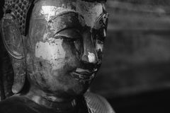Close Up Face On Buddha Head Statue And Black And White Image Style.