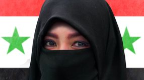 Close up face portrait of beautiful Muslim woman in traditional Islam burqa or burka head scarf posing cheerful and happy smiling stock image
