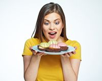 Close up face portrait of happy woman holding plate with macaro Royalty Free Stock Images