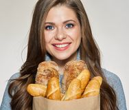 Close up face portrait of smiling woman holding paper bag with b. Aking. Isolated female portrait. Italian bread Stock Photo