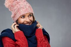 Close up face portrait of smiling woman wearing winter warm clot. Hes.  portrait Stock Image