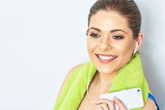 Close up face portrait of teeth smile woman with towel on neck. Listening  music on headphones Stock Photos
