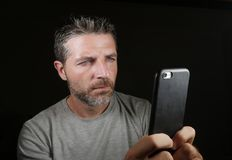 Young attractive and confident white man with blue eyes using online dating app or internet social media on mobile phone isolated. Close up face portrait of royalty free stock photos