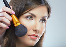 Close up face portrait of young beautiful woman. Make up brush. Royalty Free Stock Images