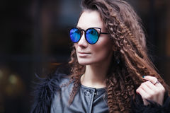 Close-up face portrait of young beautiful woman with perfect skin in Cat`s eye sunglasses in the cityscape. Beauty face. Make-up Royalty Free Stock Photos