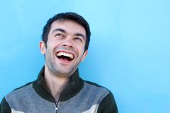 Close up face portrait of a young man laughing Royalty Free Stock Photos
