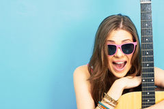 Close up face portrait of young woman with guitar Stock Photos