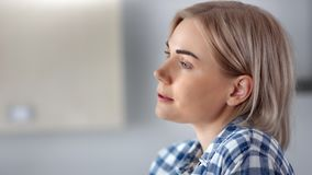 Close-up face of positive relaxed domestic woman drinking coffee enjoying weekend at home. Charming natural beauty young female dreaming enjoying hot beverage stock footage